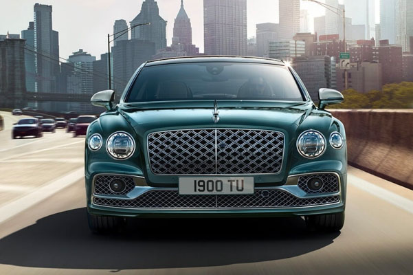 Flying Spur Hybrid front end with city behind in distance