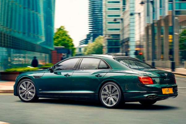 rear left angle of a Flying Spur Hybrid in the city