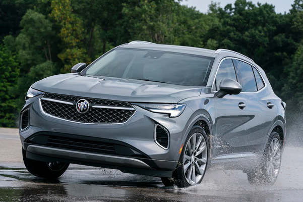 2021 Buick Envision driving over a puddle on a street