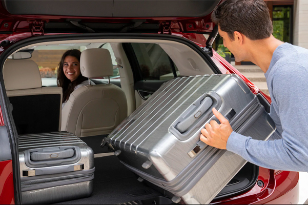 Person loading lugage into the rear of the 2021 Buick Envision