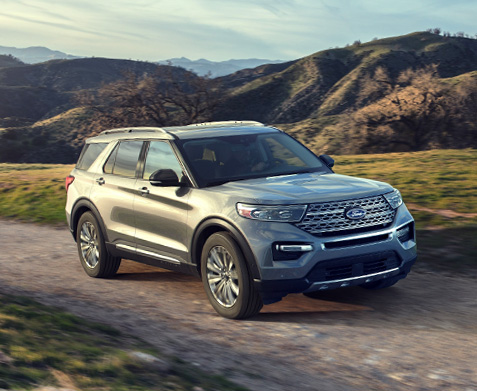 Ford Explorer driving in field