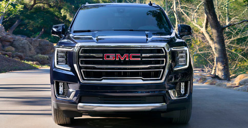 Front shot of 2021 GMC Yukon parked on a road