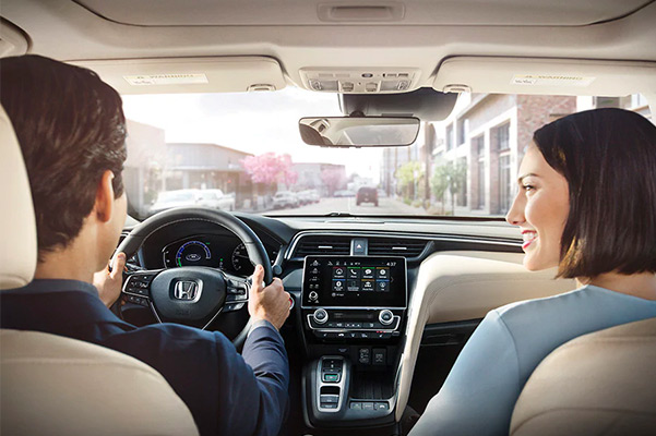 Happy couple enjoying their drive in a 2021 Honda Insight