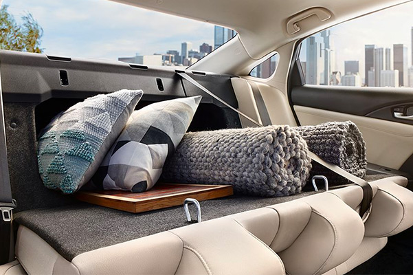The 60/40 split fold-down rear seatback folds down to reveal a sizable pass-through for those extra-large items