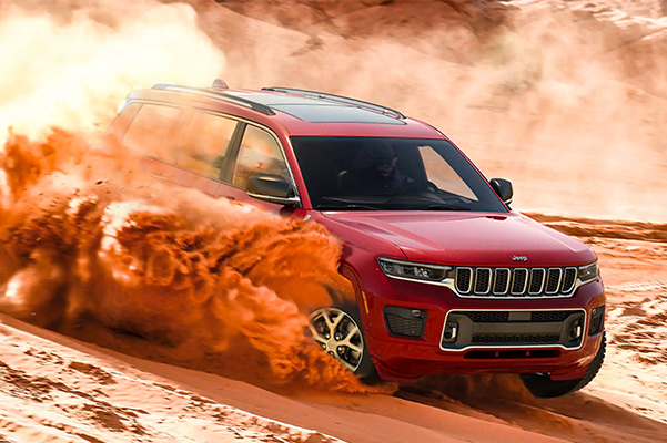 2021 Jeep Grand Cherokee L driving on sand