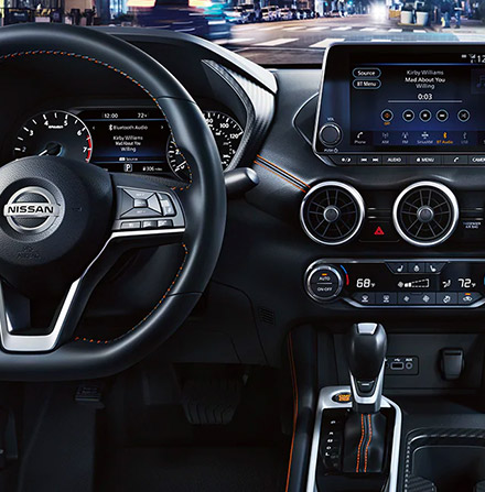 Interior shot of the 2021 Nissan Sentra to include the steering wheel and touch screen nav