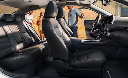 Interior shot of the front and rear seats in a 2021 Nissan Sentra