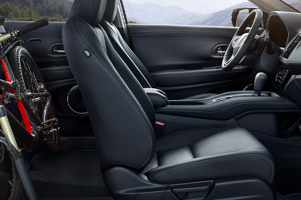 Side profile of the 2022 Honda HR-V interior with back seats down to allow a road bike in the back