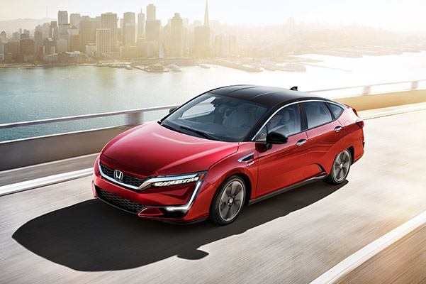 2020 Honda Clarity in action driving over a bridge