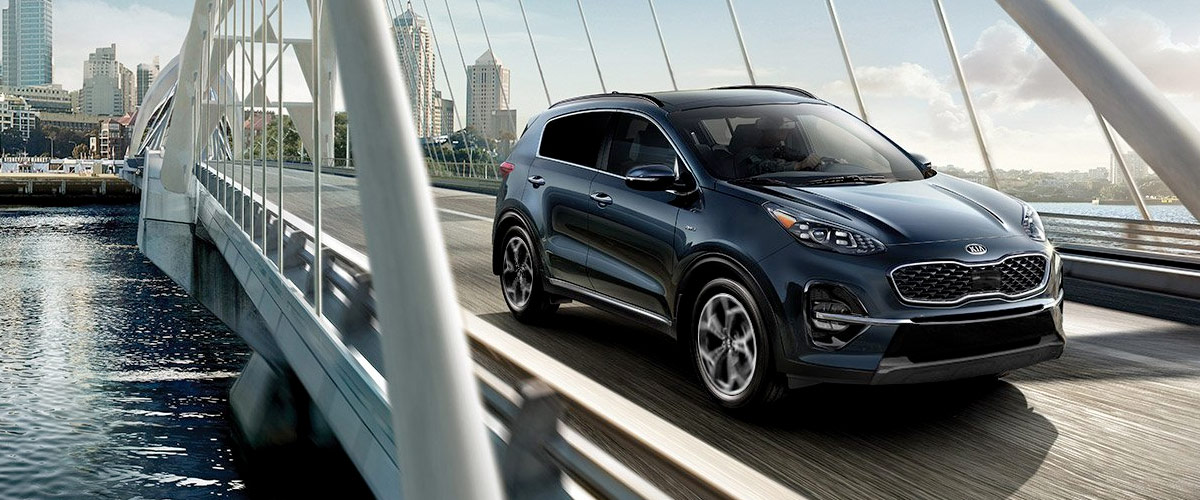 2020 Kia Sportage driving across a bridge