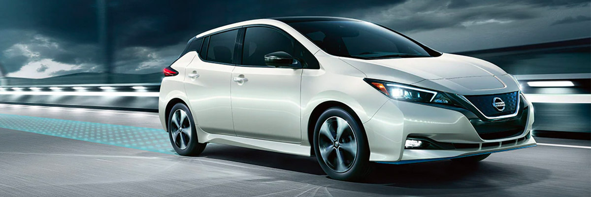 2020 NISSAN LEAF® driving down road