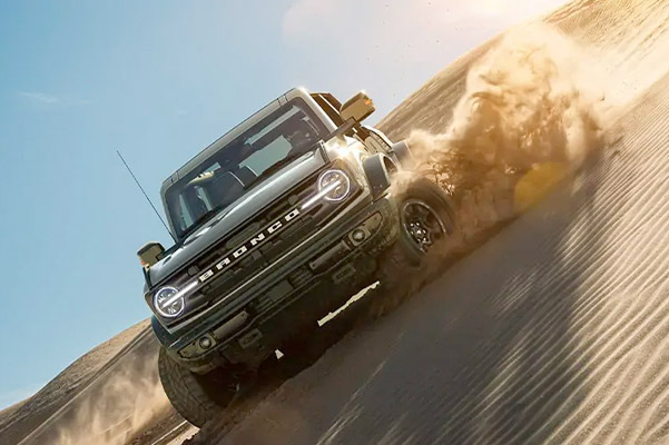 A 2021 Ford Bronco being driven over a rocky terrain