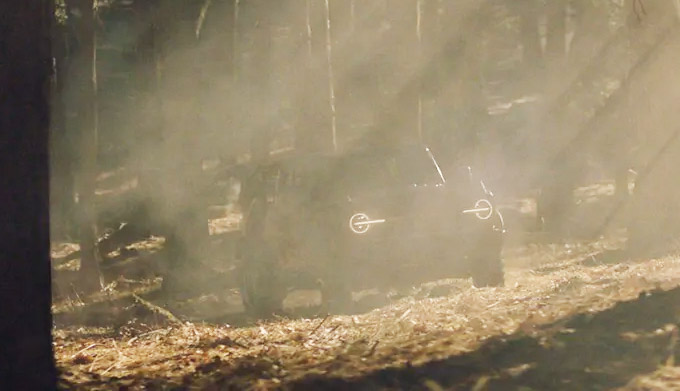 Ford Bronco driving through muddy water on its way to its destination in the wild
