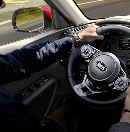 Inteior view of man holding steerign wheel while driving