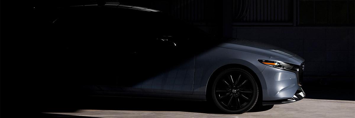 2021 Mazda3 2.5T profile view in blue