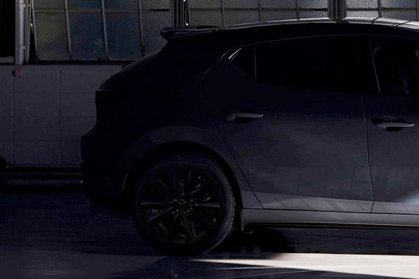 2021 Mazda3 2.5T back profile view in blue