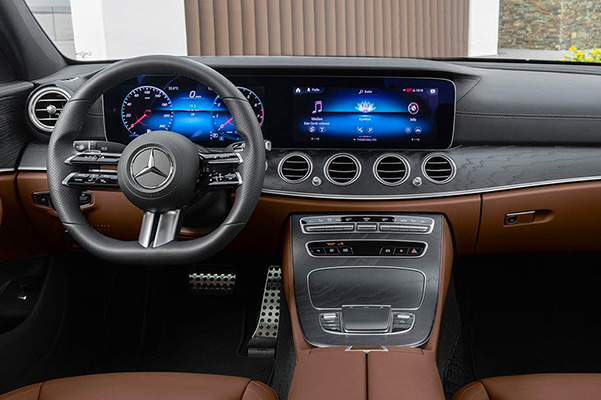 Interior shot of the steering wheel and touchscreen in the 2021 Mercedes-Benz E-Class