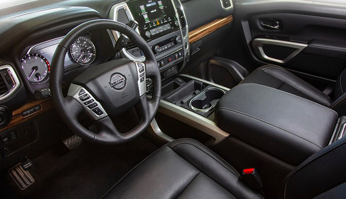 Interior dashboard view of the 2021 Toyota Titan feauring leather interior and digital screeen