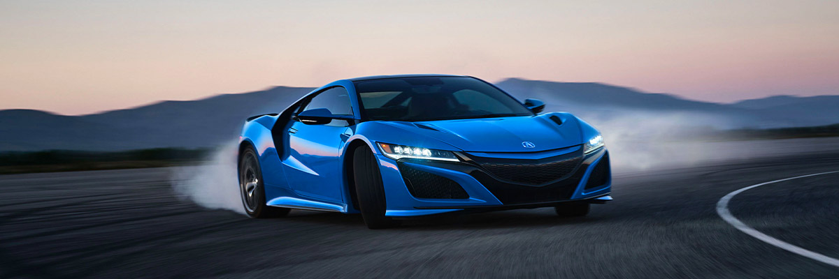 2021 Acura NSX in action coming fast around a corner