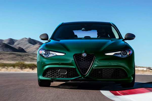 Front view of a 2021 Alfa Romeo Giulia driving on a track