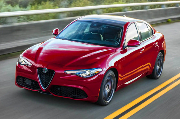 2021 Alfa Romeo Giulia driving down the road during the daytime