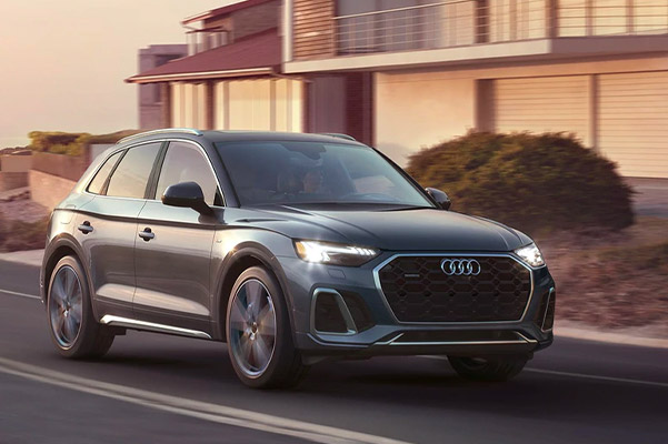 2021 Audi Q5 driving down a residential road