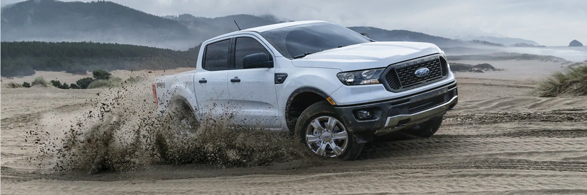 2021 Ford Ranger driving through mud