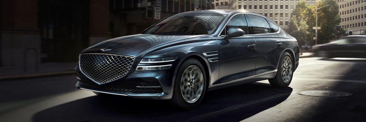 frontal profile of 2021 Genesis G80 driving down the street
