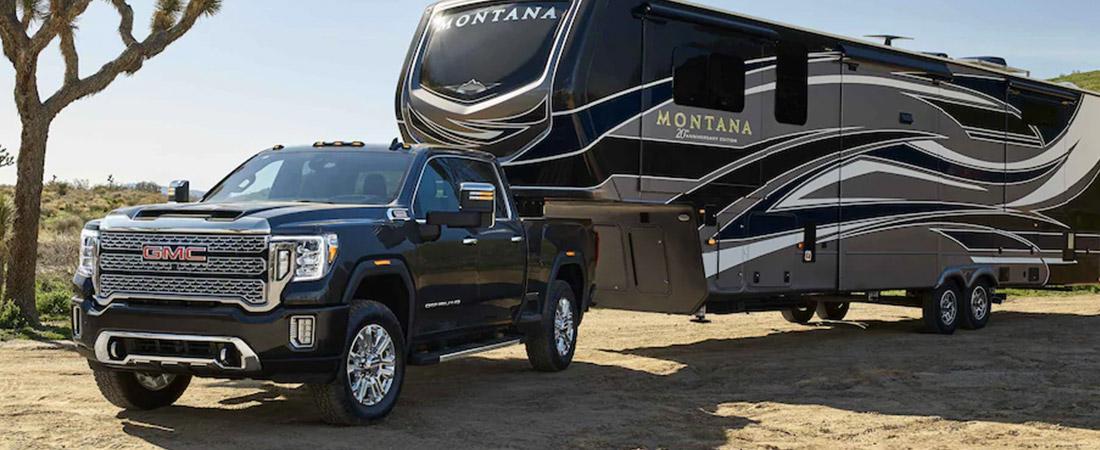 2021 GMC Sierra 2500HD towing a camper
