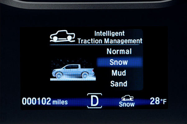 Intelligent Traction Management controls shown