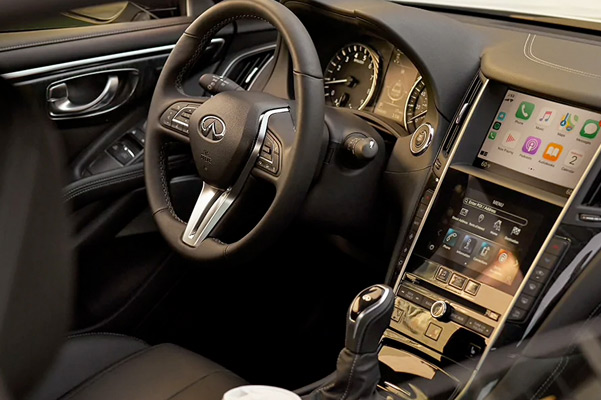 Interior view of the 2021 INFINITI Q60 Coupe Highlighting the driver console equipped with INFINITI INTOUCH and Apple CarPlay Technology
