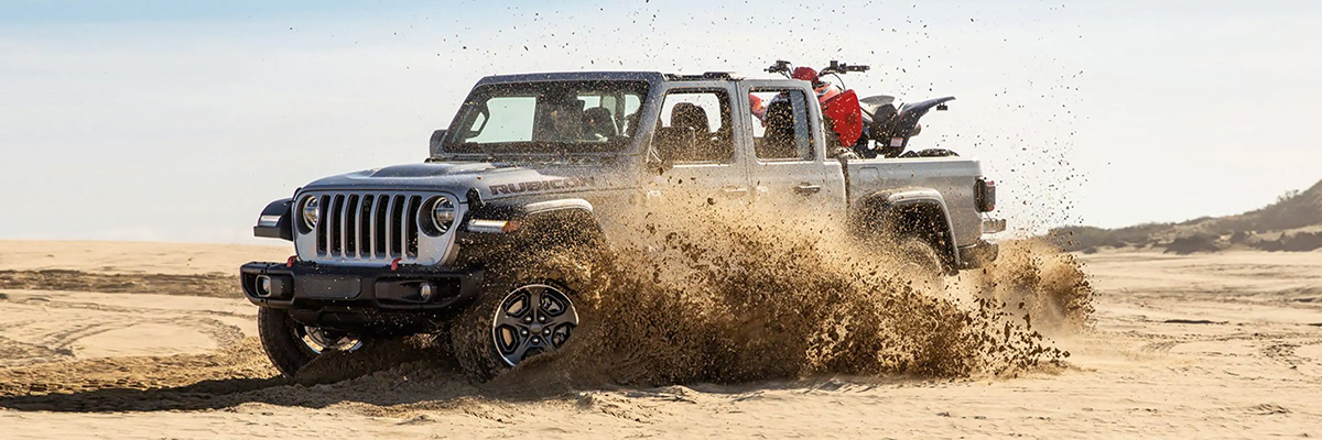 2021 Jeep Gladiator driving through sand