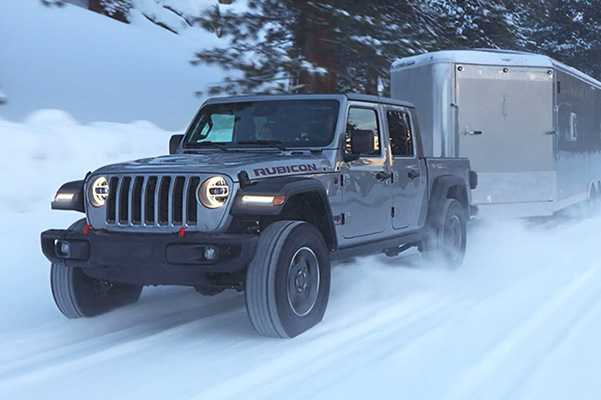 2021 Jeep Gladiator towing through snow