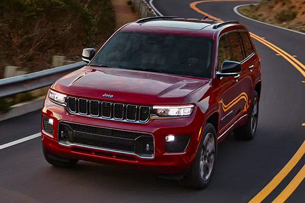 2021 Jeep Grand Cherokee L driving down a one lane highway