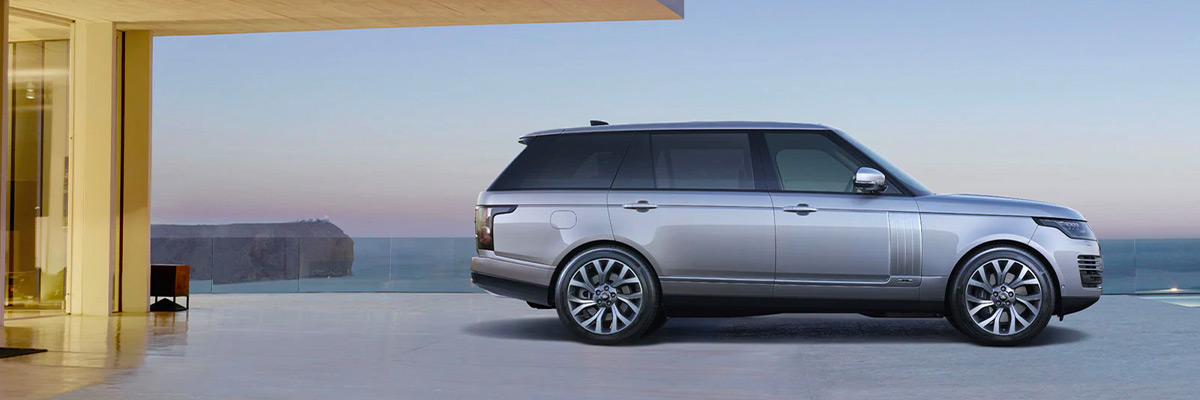 2021 Range Rover parked on a sleek driveway overlooking the ocean