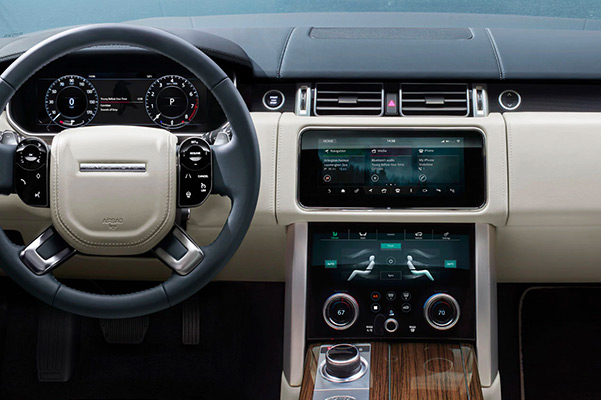 Interior dashboard of a 2021 Range Rover with touchscreen and dual climate control
