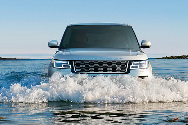 2021 Range Rover driving through a flooded street