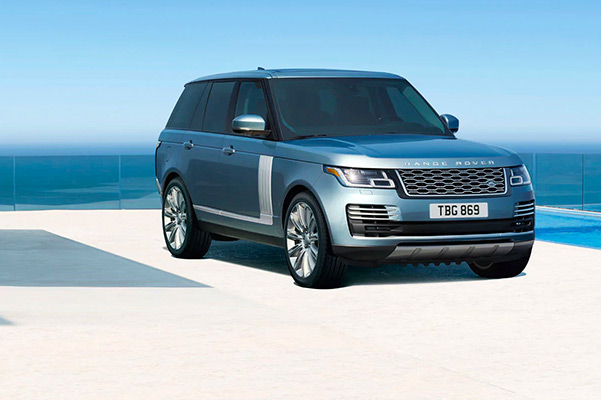 2021 Range Rover parked in a sleek driveway with the ocean in the background
