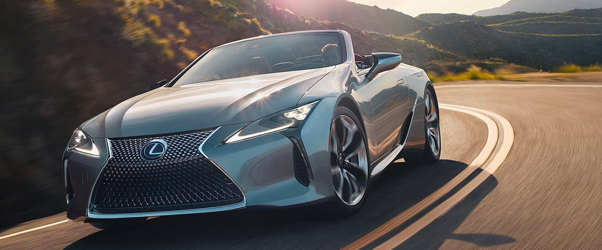 Exterior of the Lexus LC shown in driving down a scenic road