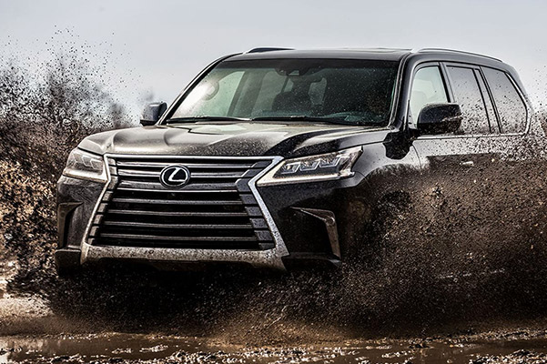 2021 Lexus LX driving through mud trail