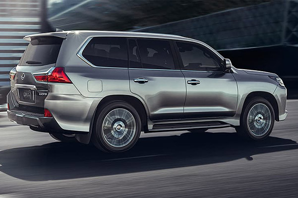 2021 Lexus LX shown in black onyx color going on heavy terrain mountain road