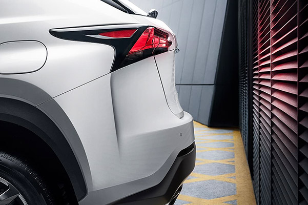 Close up of the hatchback on a 2021 Lexus NX nearing a garage door