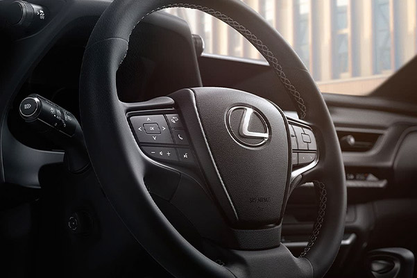 Close up shot of the steering wheel and dashboard in a 2021 Lexus UX