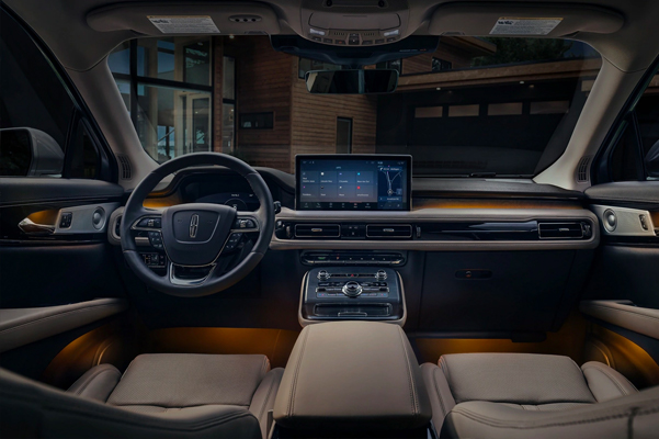The dashboard of a 2021 Lincoln Nautilus is shown demonstrating the continuous and uninterrupted space within the cabin