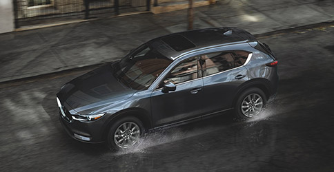 2021 MAZDA CX-5 driving on wet road