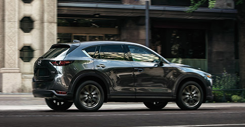 2021 MAZDA CX-5 driving on street