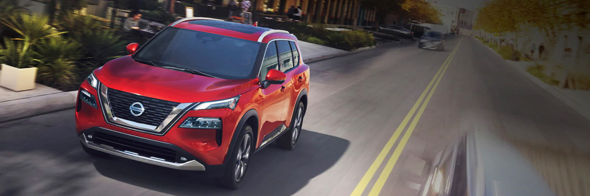 2021 Nissan Rogue driving down city street