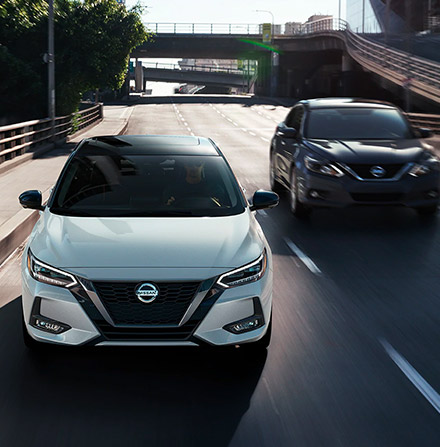 Front view of 2021 Nissan Sentras driving side by side