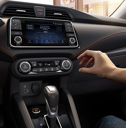 Interior shot of the 2021 Nissan Versa with touchscreen navigation