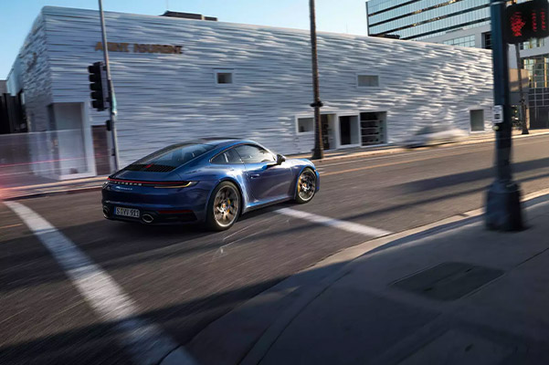 2021 Porsche 911 turning a corner at a city intersection